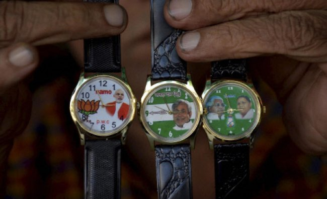 Vendor are selling wrist watches with various political parties symbols embossed in those...