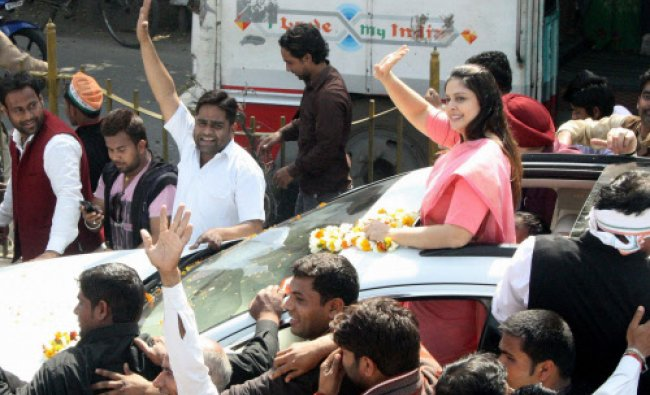Congress candidate for the upcoming Lok Sabha polls, Nagma during a road show in Meerut...