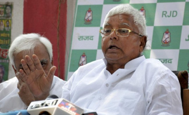 RJD chief Lalu Prasad addressing a press conference in Patna...