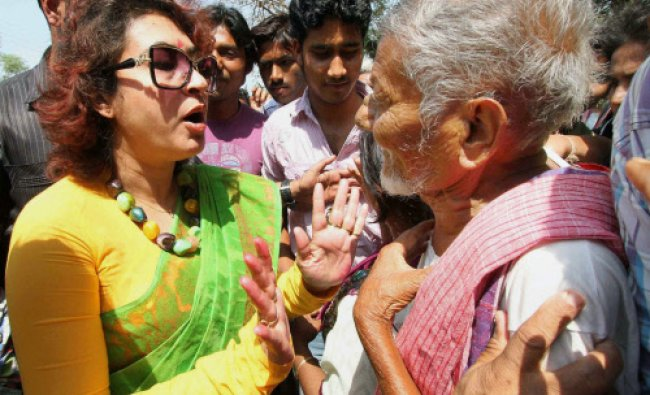 Tollywood actress and TMC candidate Satabdi Roy interacts with an elderly man in a village...
