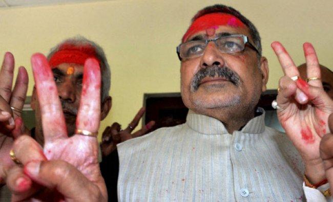BJP Loksabha candidate in Nawada constituency, Giriraj Singh showing victory sign during...