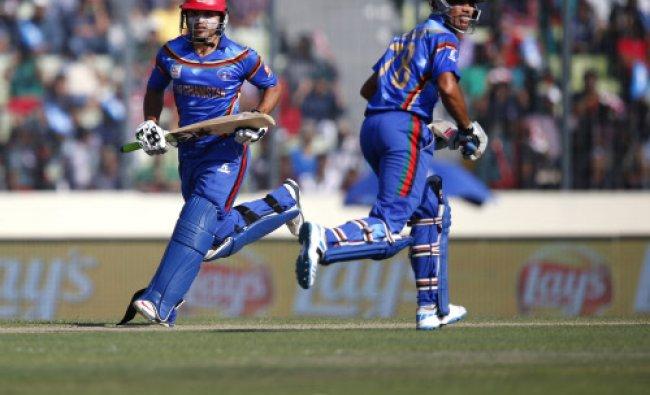 Afghanistan\'s batsmen Gulbadin Naib, left, and Najibullah Taraki run between the wickets during...