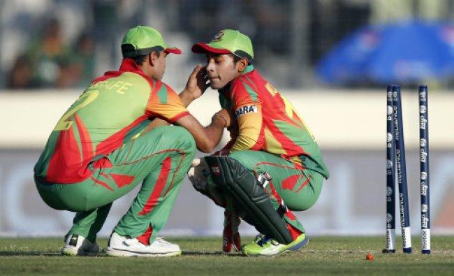 Bangladesh\'s Mashrafe Mortaza, left, attends to captain Mushfiqur Rahim after a ball hit Rahim...
