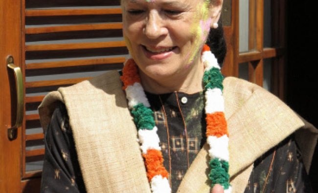 Congress President Sonia Gandhi smeared with colours on the occassion of \'Holi\' ...