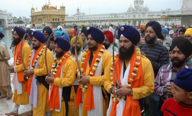Sikh Devotees perform a parikrma of Golden Temple Amritsar on the occasion of \' Holla Mohlla\'...
