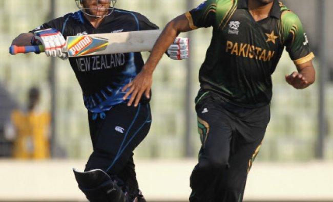 New Zealand\'s Nathan McCullum runs between the wickets as Pakistan\'s Sohail Tanvir (R) watches...