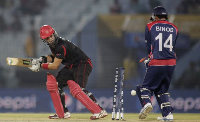 Hong Kong\'s Mark Chapman, left, is bowled out during their ICC Twenty20 Cricket World Cup match ...