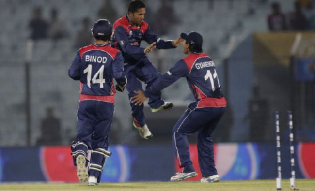 Nepalese players celebrate the dismissal of Hong Kong\'s Mark Chapman during their ICC Twenty20 ...