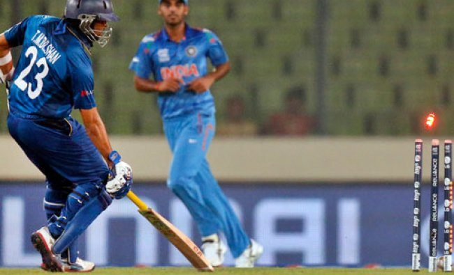 Illuminated bails fly in air after the ball hit wickets in an unsuccessful attempt by India\'s...