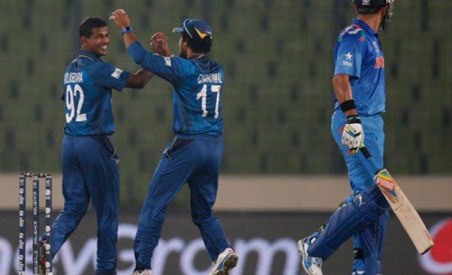 Sri Lanka\'s bowler Nuwan Kulasekara, left, celebrates with a teammate after taking the wicket of...