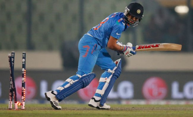 Virat Kohli is bowled out during their ICC Twenty20 Cricket World Cup warm up match against Sri...
