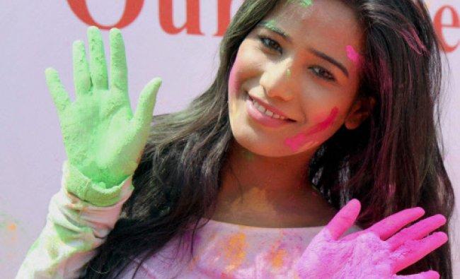Bollywood actress Poonam Pandey during Holi celebration in Mumbai on Monday. PTI Photo