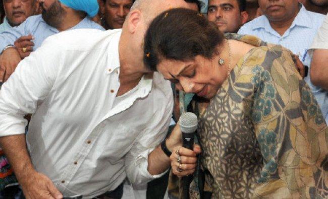 BJP Lok Sabha candidate actress Kirron Kher with husband actor Anupam Kher at a press conference...