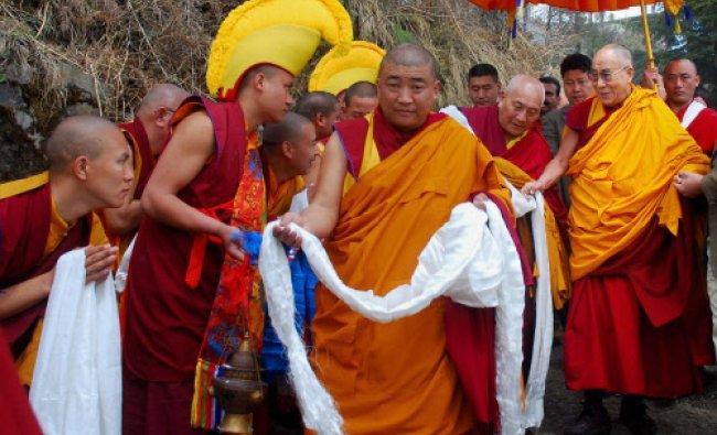 Tibetan spiritual leader the Dalai Lama meets with monks at the main Jonang Takten Phuntsok ...