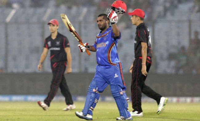 Afghanistan batsman Mohammad Shahzad acknowledges the crowd after scoring fifty runs during ...