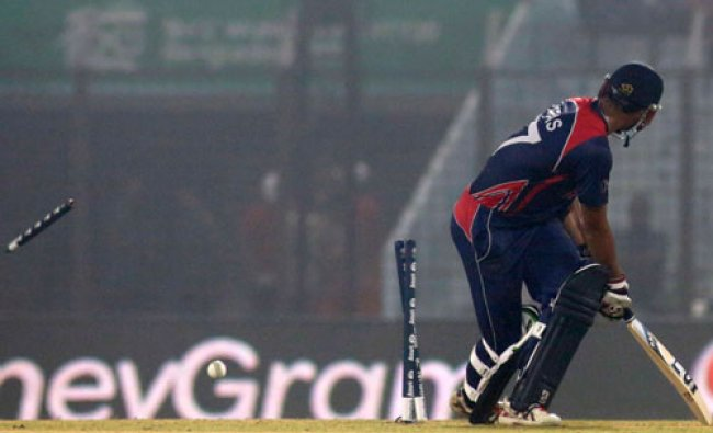 Nepal captain Paras Khadka looks back as he is bowled out during their ICC Twenty20 Cricket...