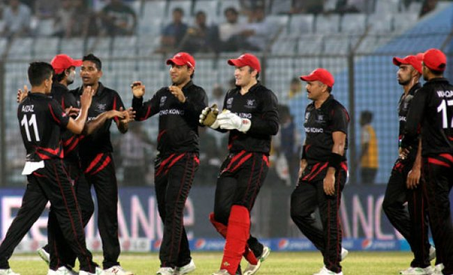 Hong Kong cricketers celebrate dismissal of an Afghanistan batsman during their ICC Twenty20...