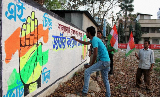 Congress workers prepare a graffiti on a wall to campaign for the upcoming Lok Sabha elections...