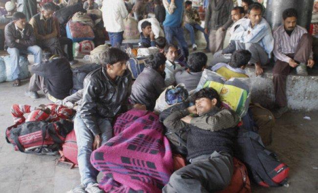 Stranded passengers at the Jammu bus terminal on Wednesday as the Jammu-Srinagar national...