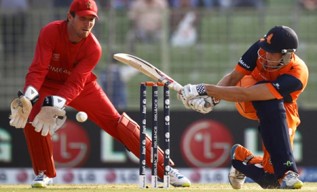 Netherlands\' Ben Cooper, right, plays a shot in front of Zimbabwe\'s captain Brendan Taylor ...