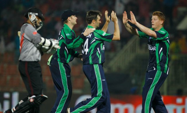 Ireland\'s Tim Murtagh, second right, celebrates with his teammates the wicket of United Arab...