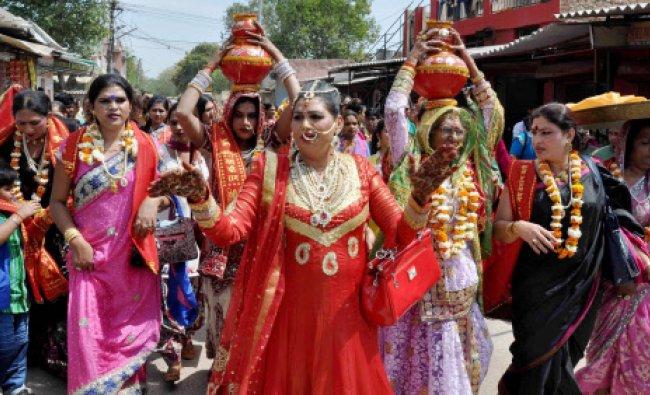 Kinnars (eunuchs) dance during International Mangla Mukhi Sammelan in Faridabad on Thursday...