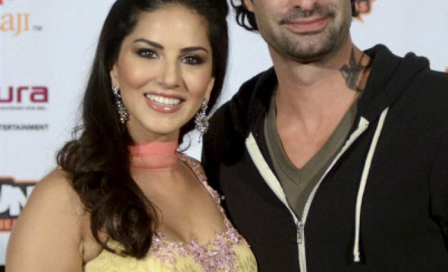 Indo-Canadian actress Sunny Leone with husband Daniel Weber after a press conference to promote...