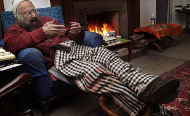 In this Dec. 20, 2010 file photo, Khushwant Singh, 96, talks sitting next to a fireplace...