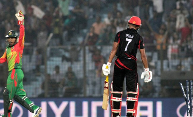 Bangladesh\'s captain Mushfiqur Rahim, left appeals successfully for the dismissal of Hong Kong\'s...