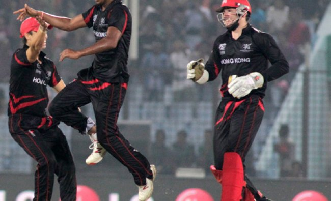 Hong Kong\'s bowler Nadeem Ahmed jumps in air as he celebrates a Bangladeshi wicket during their...