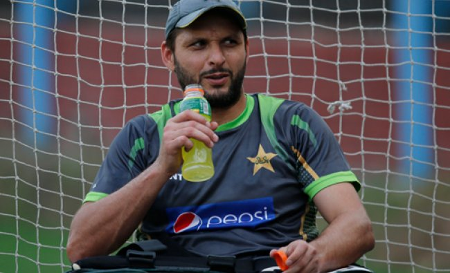 Pakistan\'s Shahid Afridi takes a break after batting in the nets during a training session ahead...