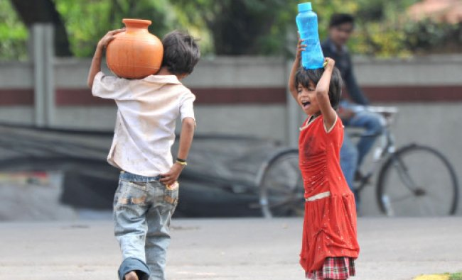 A day before of world water day, Children taking drinking water to home, at Ballal Circle in ...