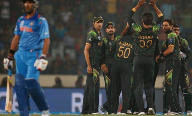 Pakistan players celebrate the dismissal of India\'s batsman Yuvraj Singh, left, during their ICC...