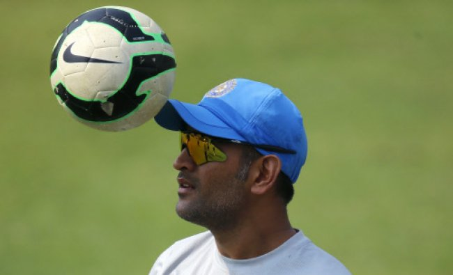 India\'s captain Mahendra Singh Dhoni plays with a soccer ball during a training session ahead...