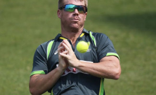 Australia\'s David Warner misses to catch the ball during a training session ahead of their ICC...