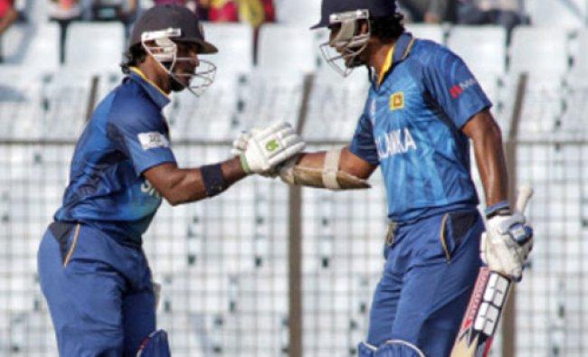 Sri Lanka\'s Kumar Sangakkara, right, congratulates teammate Kusal Perera for scoring fifty runs...