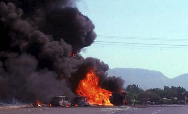 Vehicles in flames after an oil tanker collides with auto-rickshaws in Thane, Mumbai...