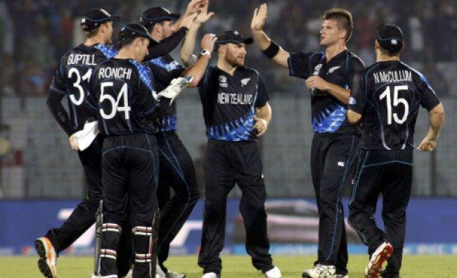 New Zealand\'s cricket captain Brendon McCullum, center, celebrates with teammates the dismissal...