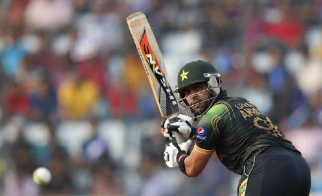 Pakistan\'s batsman Umar Akmal plays a shot during their ICC Twenty20 Cricket World Cup match...