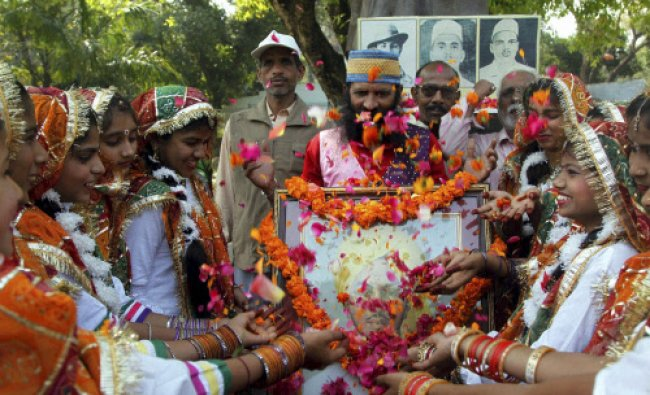 School girls paying floral tribute to pictures of Shaheed Bhagat Singh, Shaheed Sukhdev and...