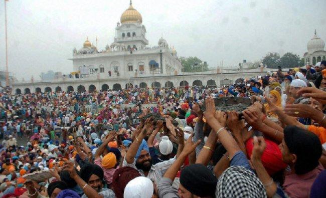 Devotees take part in Kar Seva at Gurdwara Bangla Sahib in New Delhi...