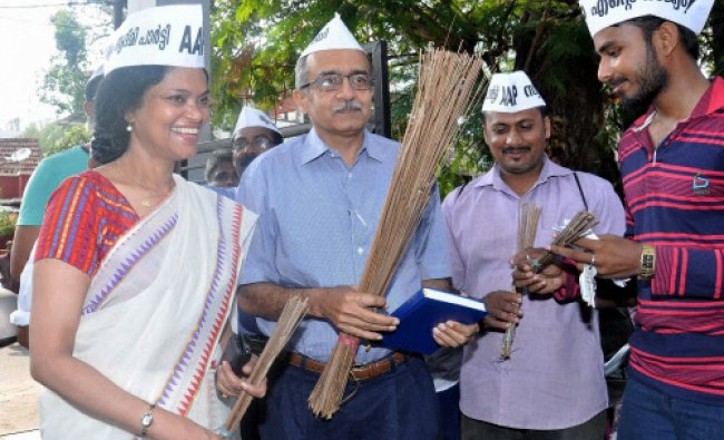 AAP candidate Anita Pratap with AAP leader Prashant Bhushan at an election campaign meeting...