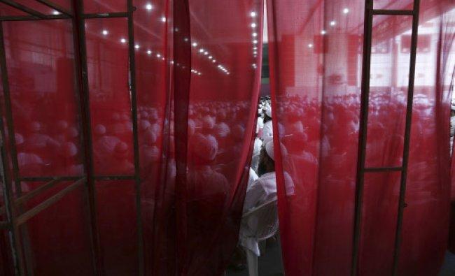 Muslims attend a meeting to protest the arrest of Islamic scholar Maulana Abdul Qavi Qavi...
