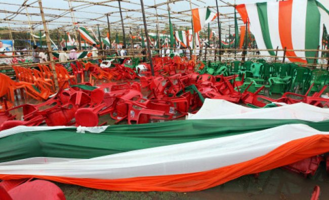 Destroyed pandals after heavy rains at Congress workers convention which was to be addressed...