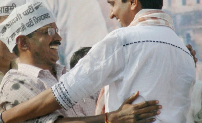 AAP convener Arvind Kejriwal with party leader Kumar Vishwas during a public rally...