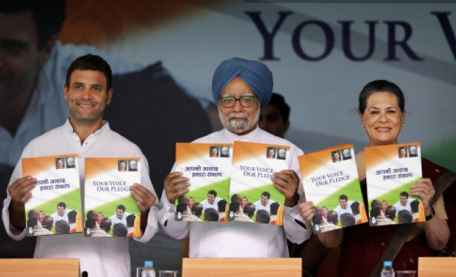 Congress party Vice President Rahul Gandhi, Indian Prime Minister Manmohan Singh, and Congress...