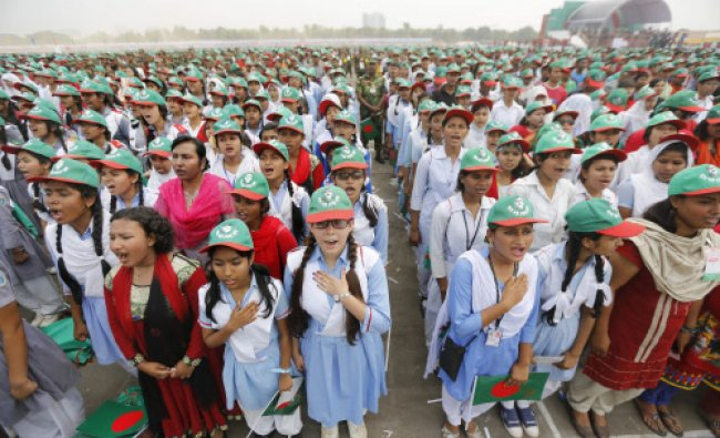 People sing the national anthem of Bangladesh in an attempt to break a Guinness record at a...