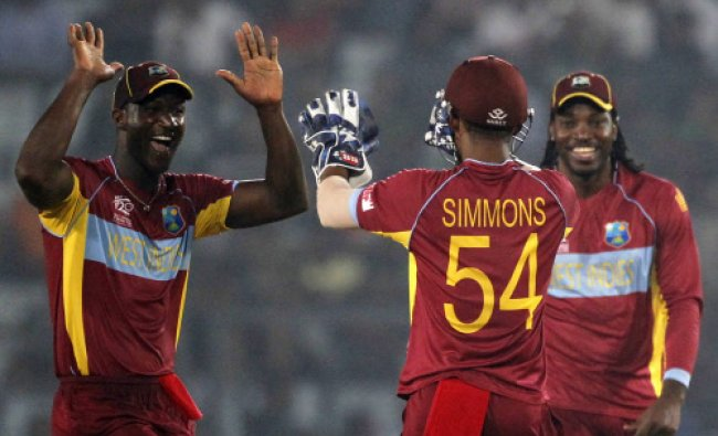West Indies\' captain Darren Sammy celebrates the dismissal of Bangladesh\'s captain Mushfiqur...