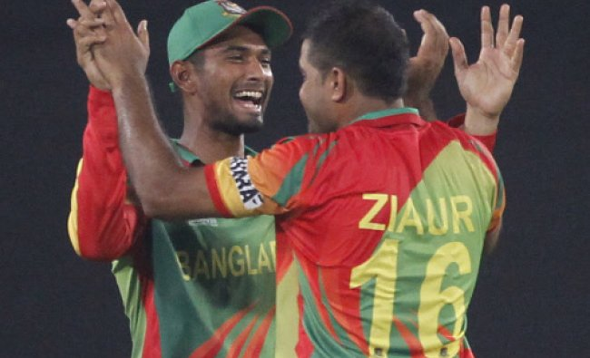 Bangladesh\'s Mahmudullah congratulates Ziaur Rahman as he dismissed West Indies\' Chris Gayle ...
