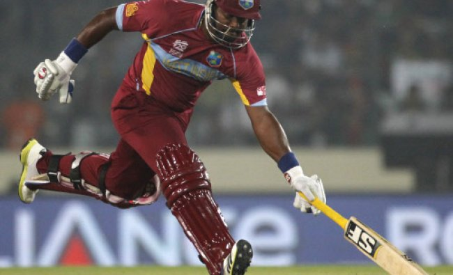 West Indies\' Dwayne Smith runs between the wickets during their ICC ...